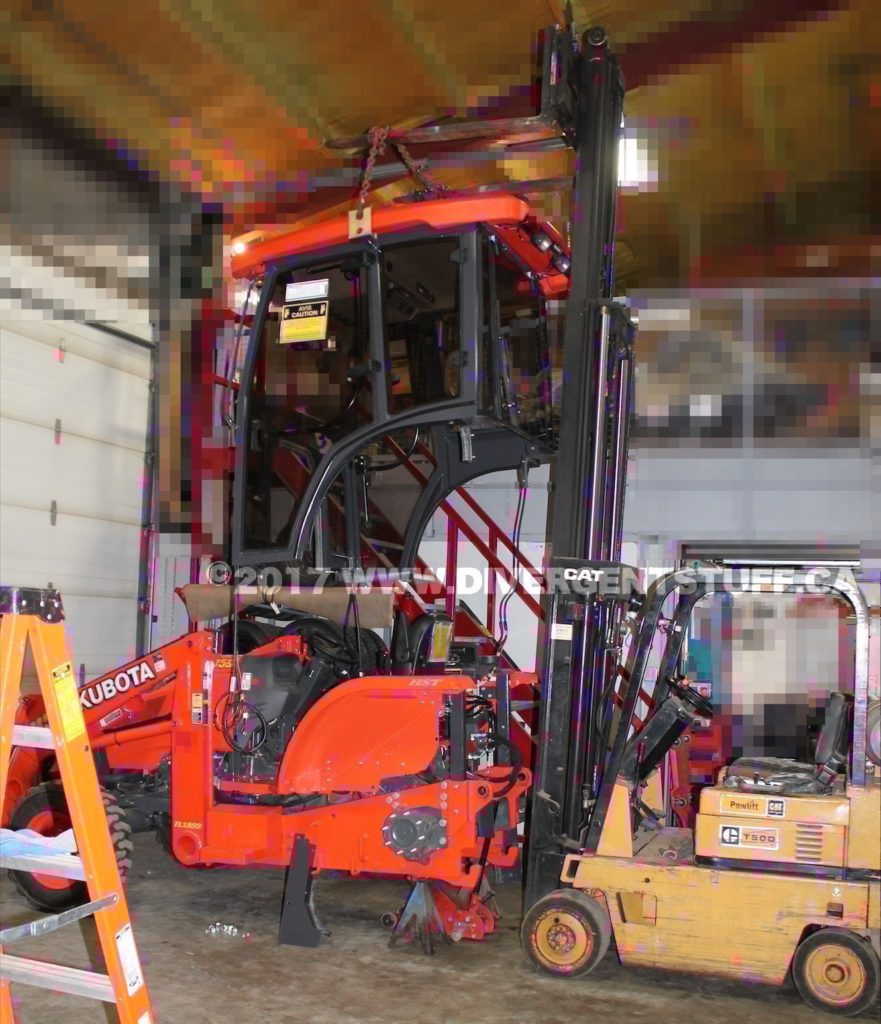 Photo showing the cab being lowered onto the chassis