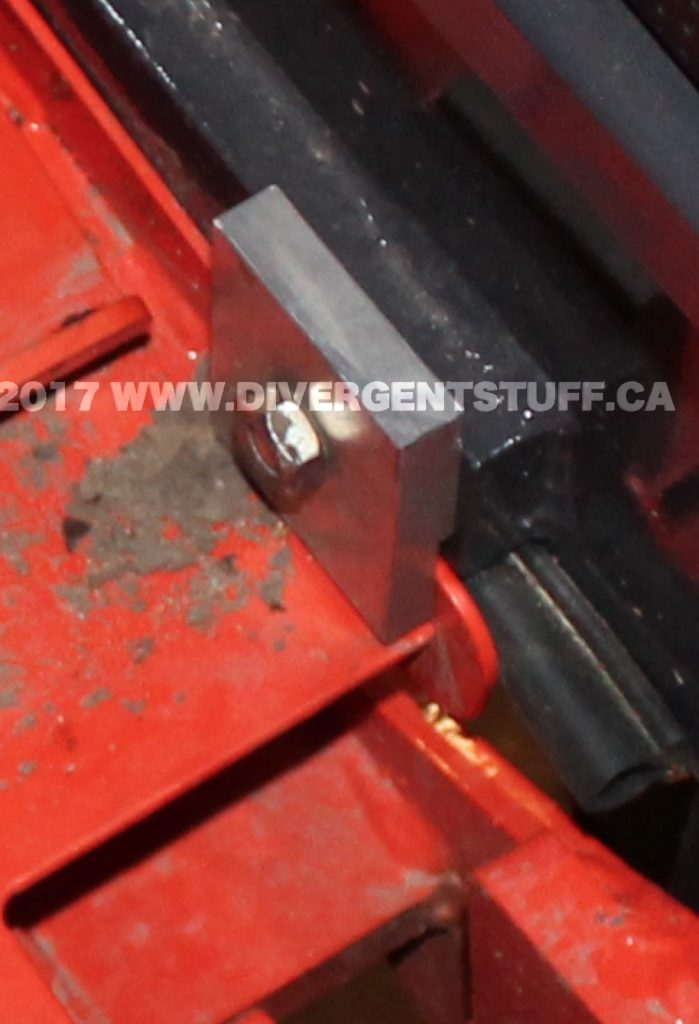 Close up of the fabricated aluminum nut to clamp on to the backhoe deck skirt.