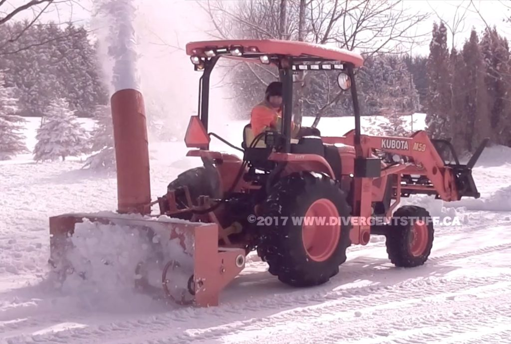 M59 cleaning wet snow with rear mounted snow blower