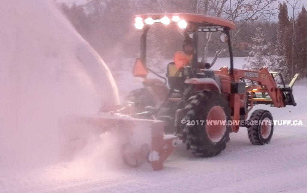 M59 cleaning powder snow with rear mounted snow blower